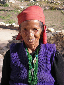 Old lady with interesting necklace in Nako.