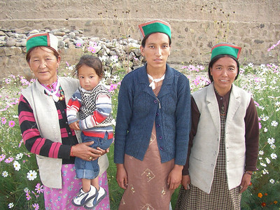 The local lady and her family visiting the gompa.