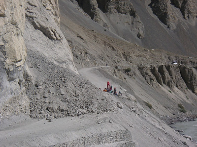 Women clearing a landslide by hand. It was good news for me as it kept the traffic back.