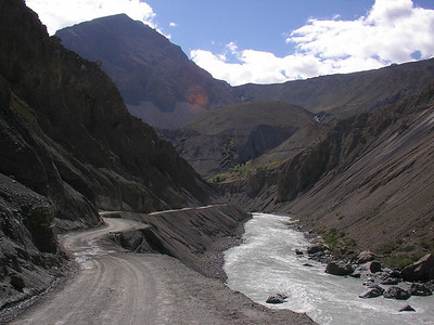 The dirt main road next to the Chandra River.