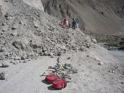 No problem for me, I just carried the panniers then the bike over the rubble, and rode on.