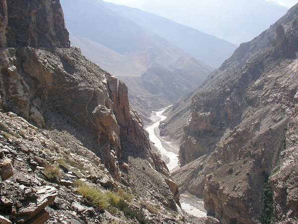 The road snaking around the cliff face high above the river.